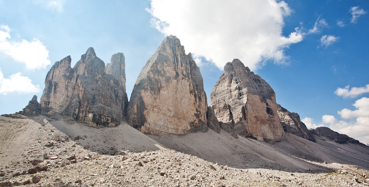 Cima Grande is the larger, central mountain of Tre Cime di Lavaredo with the route following the black streaks on the right. Photo © Ollie Griffiths